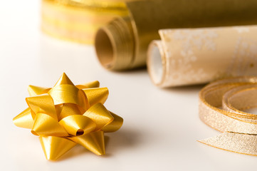 Golden wrapping paper and bow present decoration