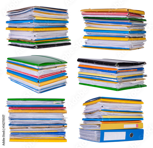 Stacks of papers and documents isolated on white
