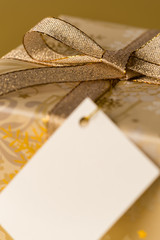 Christmas gift with blank tag gold ribbon