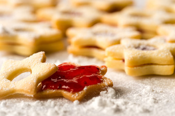 Christmas cookie stars with strawberry jam