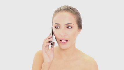 Beautiful model talking on her smartphone