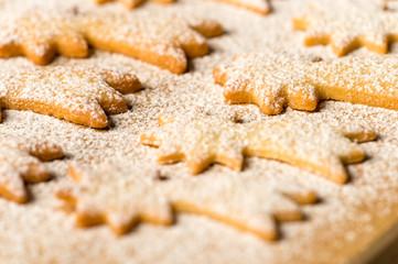 Baking christmas cookies comet star powdered sugar