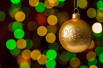Christmas ball hanging defocused sparkling lights