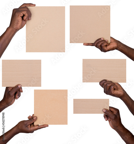 Man holding pieces of cardboard