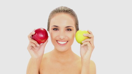Beautiful model holding red and green apples