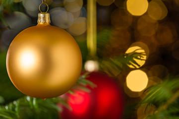 Gold christmas ball hanging on Xmas tree