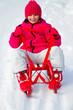 Winter, sledding - young girl enjoying winter