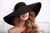 Fashion woman in hat with red lips. Beauty woman portrait with l