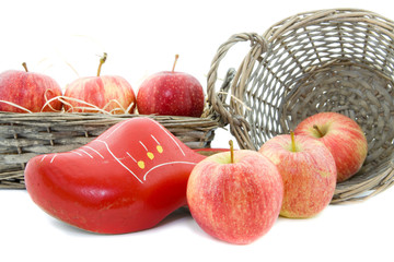 red apples and wooden shoe