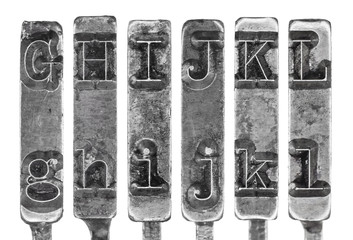 Old Typewriter Typebar Letters G to L Isolated on White