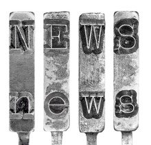Word NEWS in Old Typewriter Typebar Letters Isolated on White