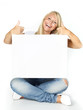 Smiling woman with message board shows thumbs up