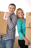 House moving. Beautiful middle-aged couple standing close to eac poster