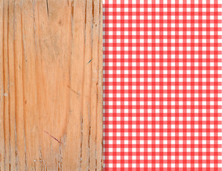 Wooden cutting Board on the red checked tablecloth