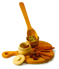 spices in a wooden bowl on a white background