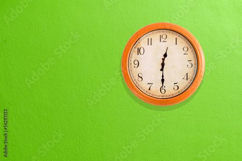 Leinwanddruck Bild Clock showing 12:30 on a green wall