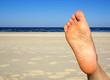 Fuß mit Strand und Meer