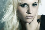 beautiful blond girl with smoky eyes.make-up.black ring