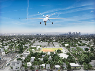 Surveillance UAV drone flying over a residential neighborhood