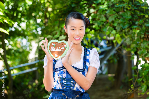 Asian Woman with Bavarian gingerbread heart