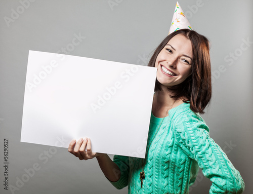 young brunette woman holding blank sign