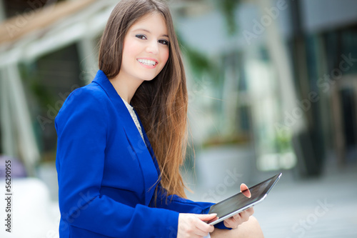 Businesswoman using a tablet outdoor