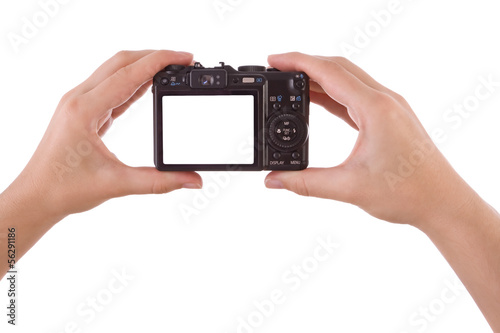 Hand photographing with a digital camera isolated on white