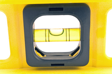 Macro of a yellow spirit level on white