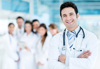 Doctor with medical staff