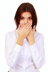 beautiful surprised woman with hands over her mouth