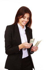 Happy businesswoman counting cash isolated on white