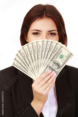 Happy businesswoman covering her face with dollars