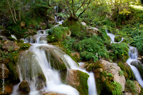 Waterfall on moss covered rocks