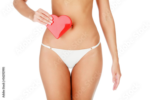 Woman with a red heart, white background.