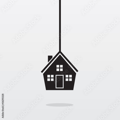 House hanging from a rope or string