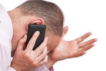 Frustrated man talking on the phone