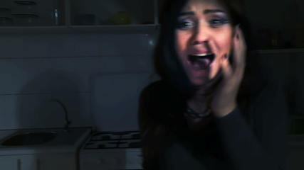 Screaming woman in home at halloween night. Horror.