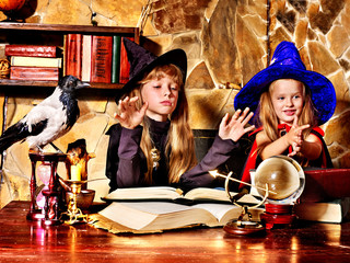 Witch  children with crystal ball.