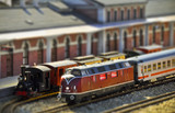 Steam and diesel trains on the railway station. Tilt shift