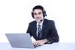 Businessman with laptop and headset