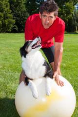 Yoga Dog looks at trainer