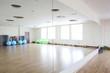 bright gymnasium with big mirror