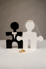 Wedding ring and grooms hands with puzzle