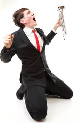 Young man with trumpet isolated