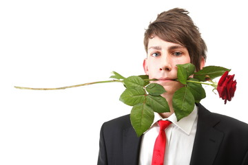 Young man with red rose isolated