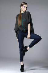 full length fashion girl posing gray background