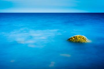 Rock in the still water