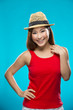 Fashionable Asian Woman wearing straw hat.