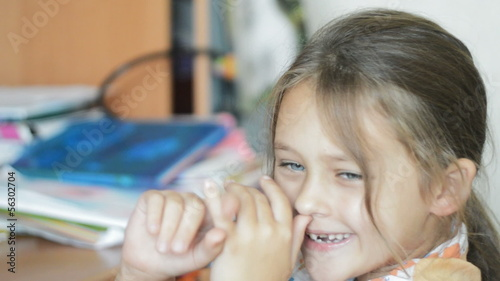 kid fooling around, twisting her fingers in the nose