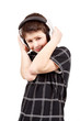 Portrait of a happy smiling young boy listening to music on head